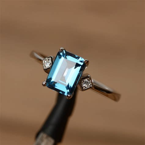 blue topaz ring emerald cut ring gemstone engagement