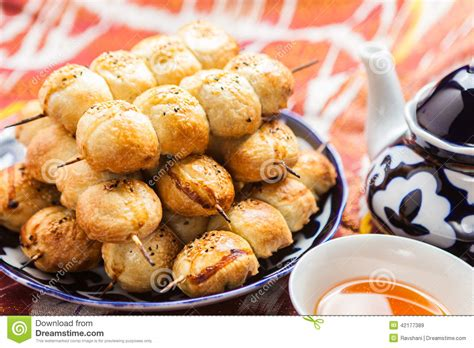 uzbek national cuisine main courses uzbek national food samsa on traditional fabric adras