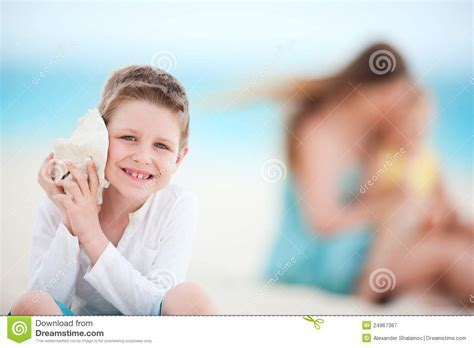 cute boy royalty free stock photography image 26641147 cute boy with seashell royalty free stock photography