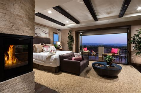 The extraordinary master bedroom boasts a unique tray ceiling entry, a private retreat, dual