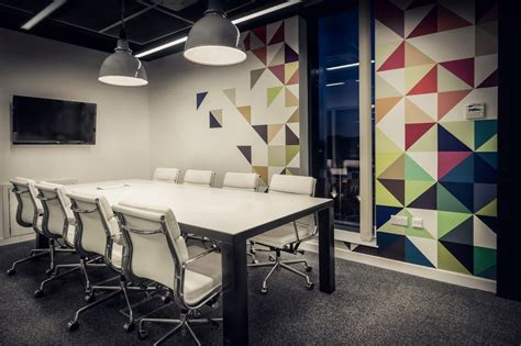 quidco office meeting room with custom steel frame table with corian top reclaimed industrial