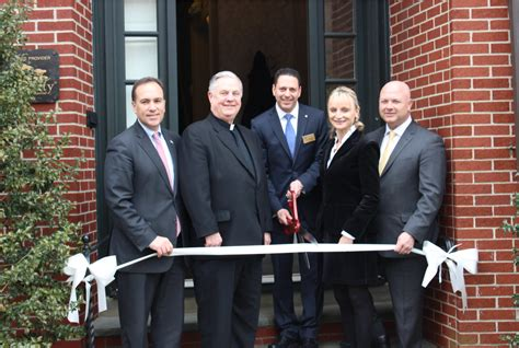 gallagher funeral home cuts ribbon after major renovation