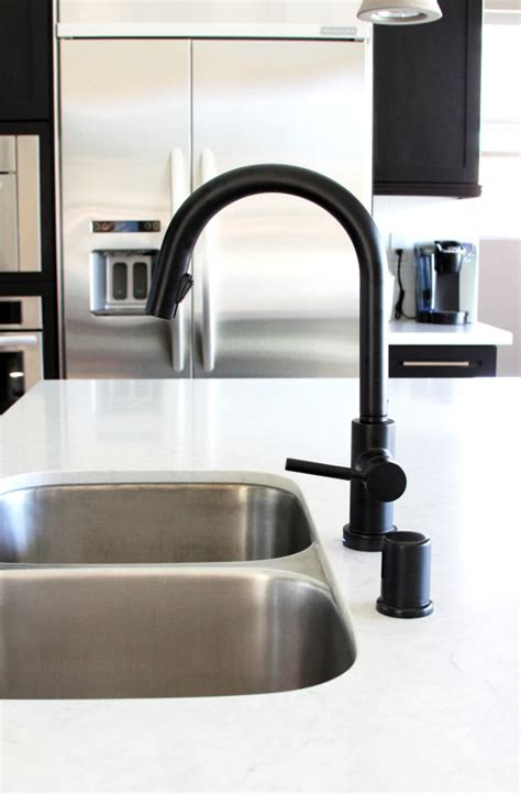 black faucets kitchen black is the new black design milk