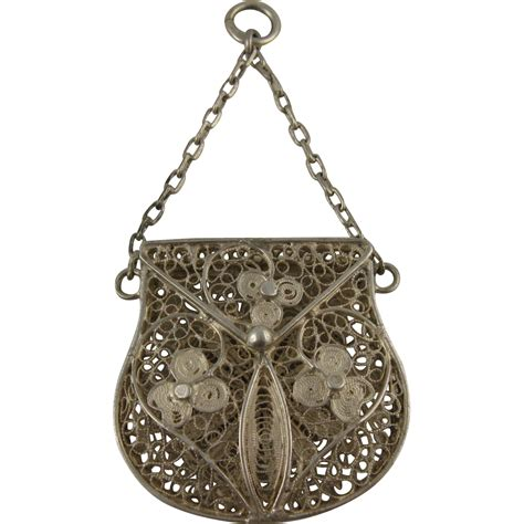 reserved antique silver filigree purse locket