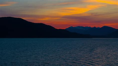 Sunset On The 3rd Vol 1 5 End bicycle rides across pier or dock in haines alaska wooden pillars standing in beautiful