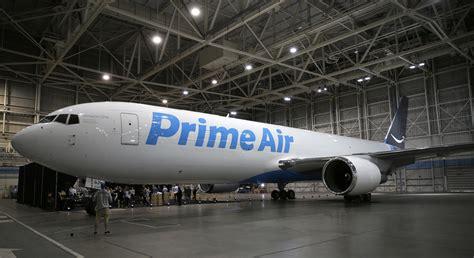 unveils cargo plane as it expands delivery network chicago tribune
