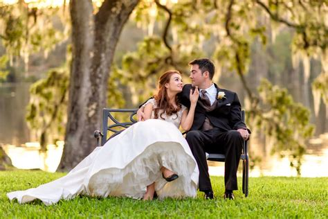 couple sitting on bench beautiful river sunset with a bride and groom at wachesaw plantation
