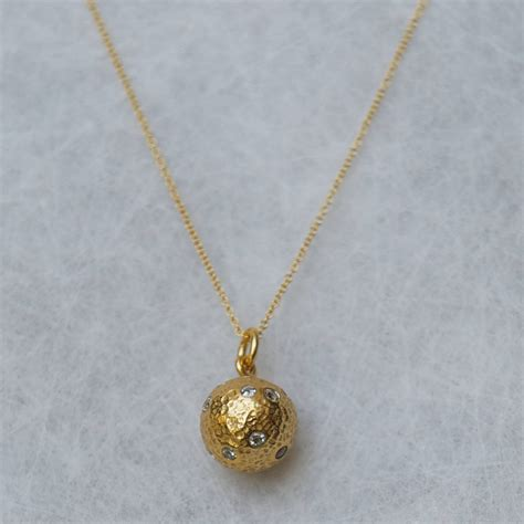 gold and zircon pendant necklace by rochelle shepherd