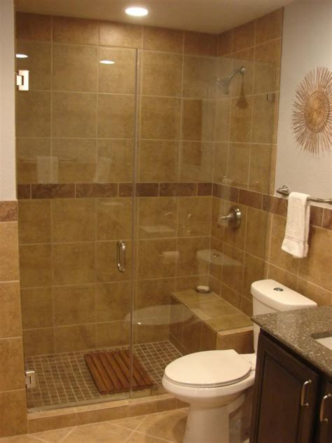 small bathrooms with shower only metal knob above toilet beside vanity white wooden swing glass