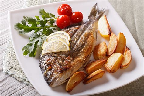 come cucinare il pesce al forno cucinare pesce arrosto guida il giornale cibo
