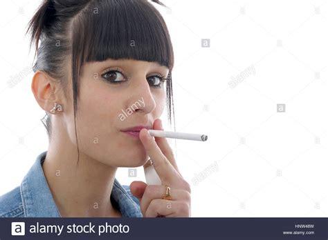young girl smoking cigarette stock photos images pretty young woman smoking cigarette stock photo royalty