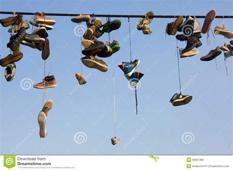 hanging photos on wire shoes hanging on wire stock photo image 32927380