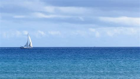 sailing boat in the sea sail boat in the distance sailing the sea stock footage