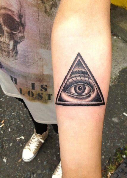 left eye tattoo grey ink illuminati eye on left arm
