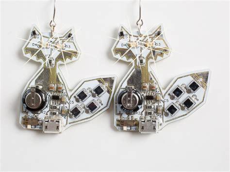 blinky led white fox earrings lumen electronic jewelry