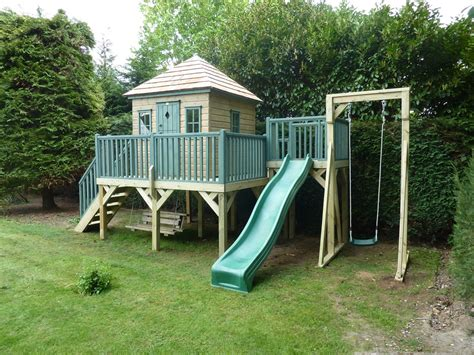 playhouses with slide and swings childrens wooden playhouse treehouses the playhouse