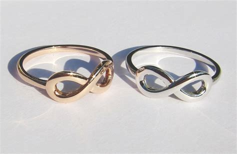 His and Hers Infinity Knot Wedding Rings   OneWed.com