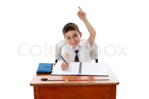A Little School Boy Student Sitting At Desk And With One Students At Desk