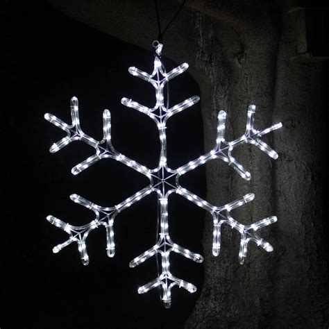 twinkling snowflake light by lime tree london