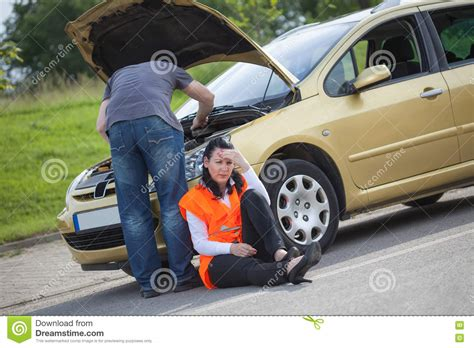 woman driver on the phone for car breakdown female driver calling to a car assistance after breakdown