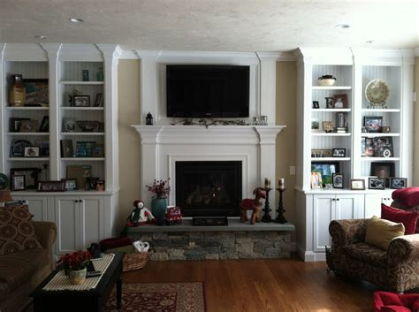 fireplace with bookcases wood trim for the home