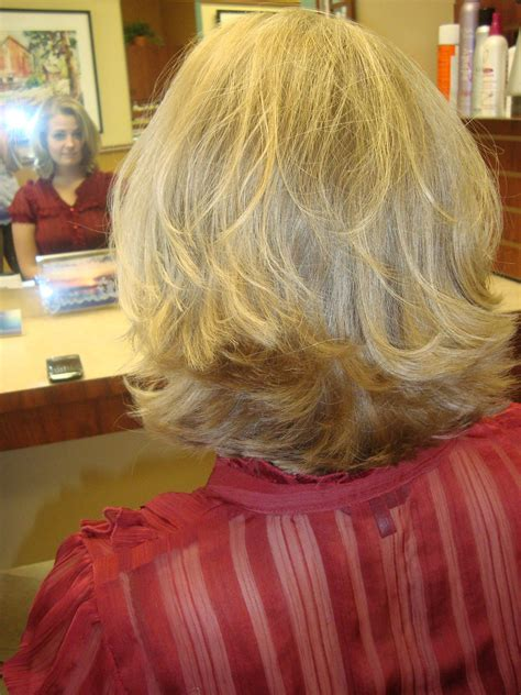 flipped out layered hairstyles short thick and blonde flipped hair low maintenance and