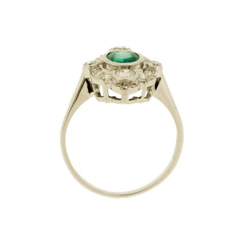 deco revival emerald and marquise ring from