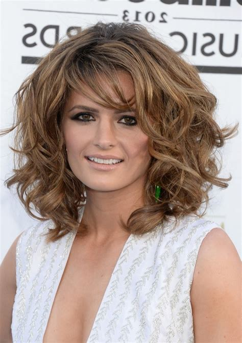 Hairstyles With Bangs For Thick Hair by Stana Katic Layered Medium Curly Hairstyle With Bangs For