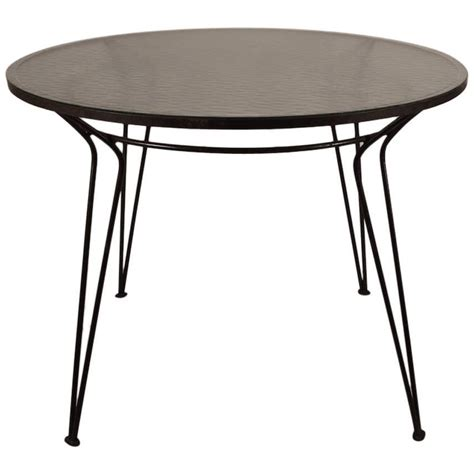 wrought iron table with textured glass top after salterini at 1stdibs