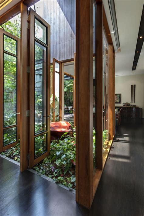 courtyard definition lush gardens and peekaboo roof pool define modern property