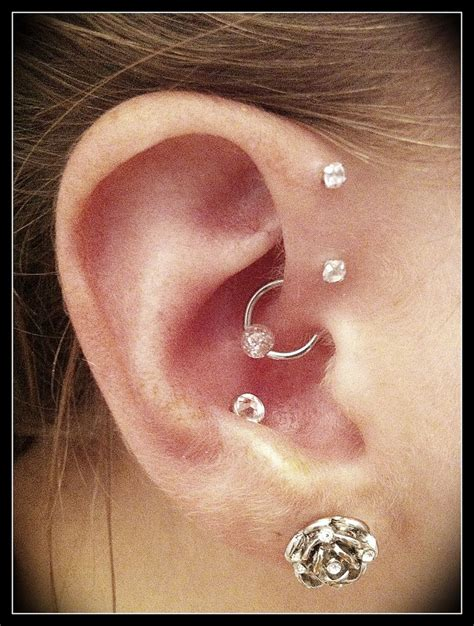 forward helix daith and conch piercings ink