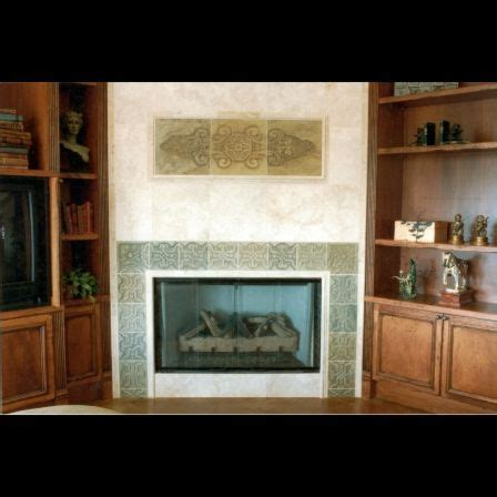 custom carved slate fireplace surround and panel by