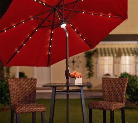 solar lighted patio umbrella light up the with this solar patio umbrella