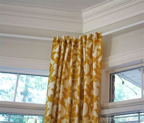 hanging curtains in a bay window curtain rods bay window curtain rod and hanging curtains