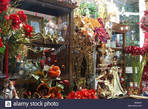 christmas decorations and flowers in a shop window