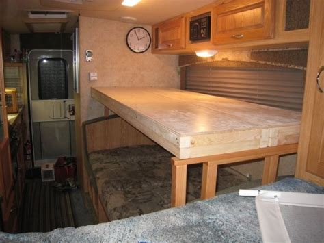 rvs with bunk beds creating a bunk bed over a dinette in a trailer rv