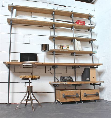 above desk shelving unit reclaimed scaffolding boards and dark steel pipe