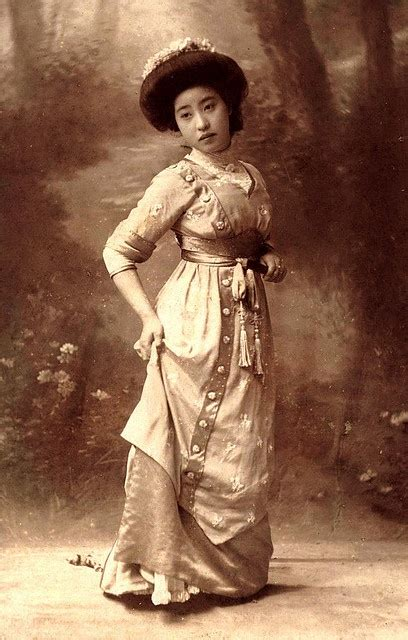 classic old fashioned 1905 meiji era portrait of a japanese experimenting