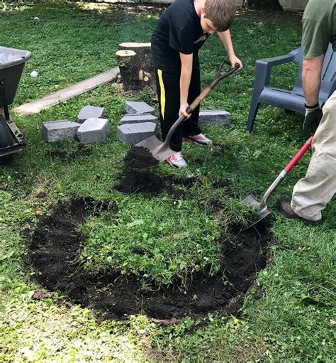 how to dig a fire pit in your backyard diy fire pit in under two hours 1915 house