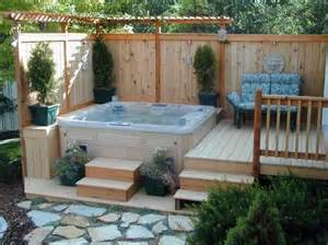 corner deck tub with small pergola and vertical
