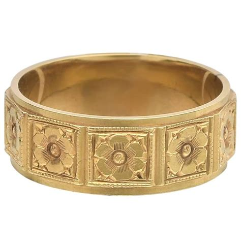 I Ring Mica Motif yellow gold floral motif band ring for sale at 1stdibs
