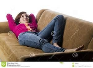 laying on a sofa stock image image 7290611