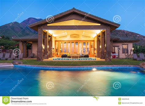 buy a house with swimming pool swimming pool in luxury home stock photography