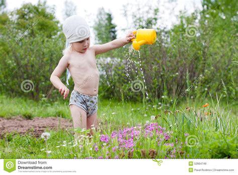 girl watering flowers girl watering flowers stock photo image 52664749