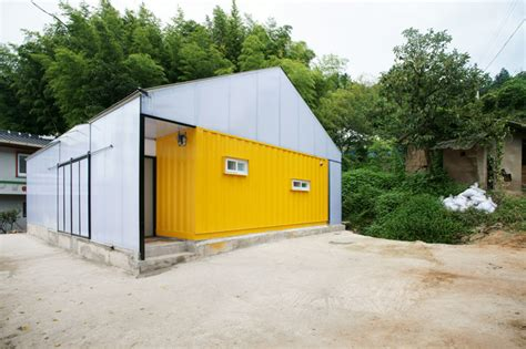 Humanitarian Low Cost House With Shipping Container Rooms