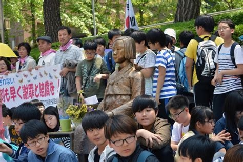 japan korea comfort women japan steps up demand for removal of comfort woman statue