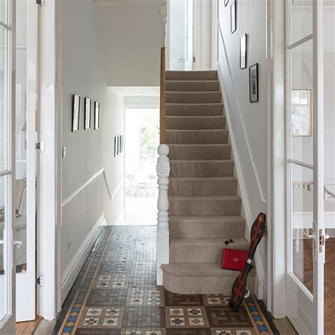 white hallway with tiled floor hallway decorating