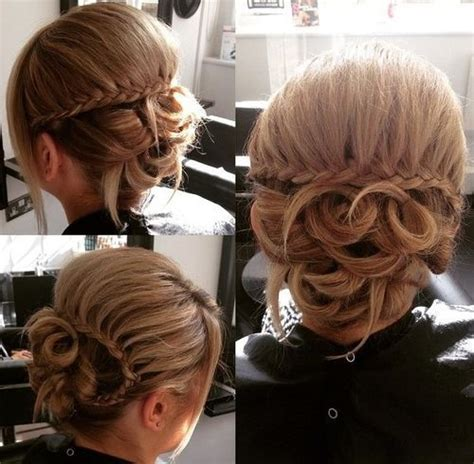 hair that comes to a point in the back looped updo with waterfall braid