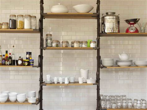 kitchen features vintage industrial shelves leaning