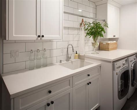 white laundry room cabinets black and white laundry room with herringbone tile floor